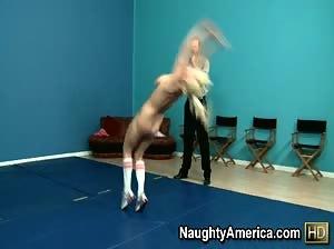 Hot blond fucks her coach on the wrestling mat.